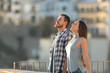 Leinwanddruck Bild - Happy couple breathing fresh air in a town