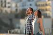 Leinwanddruck Bild - Happy couple in a town breathing fresh air
