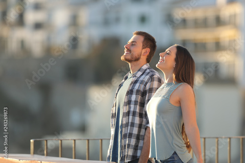 Leinwanddruck Bild Happy couple breathing fresh air in a town