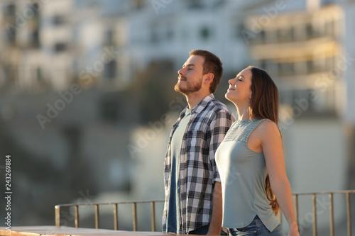 Leinwanddruck Bild Happy couple in a town breathing fresh air