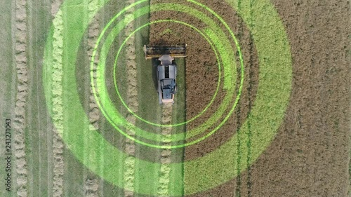 Electric combine, harvester removes oats, view from height, tracking GPS system, HUD, motion graphics elements.