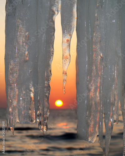 Transparent icicles at sunset - 243278481