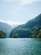 Leinwanddruck Bild - Landscape with lake against mountains