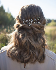 Beautiful woman with hairstyle wearing pearl hair accessory © Mikhail Malyugin