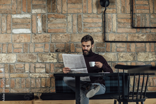A Man Reading Daily Newspaper - 243280094