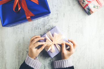 woman hand different gift boxes
