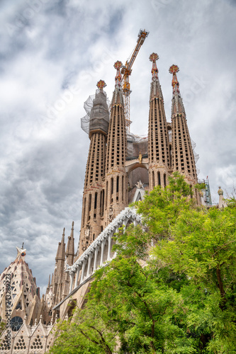 BARCELONA, SPAIN - MAY 14, 2018: Cathedral of La Sagrada Familia on a cloudy day. It is designed by architect Antonio Gaudi and is being build since 1882