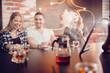 Group of friends man women met in cafe, smoking shisha hookah, drinking tea, chatting