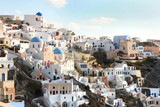 Oia town with tradional buildings painted white on the cliffside, Santorini, Cyclades, Greece. - 243292476