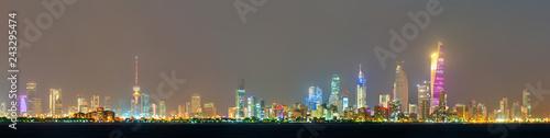 Leinwanddruck Bild Night skyline of Kuwait City