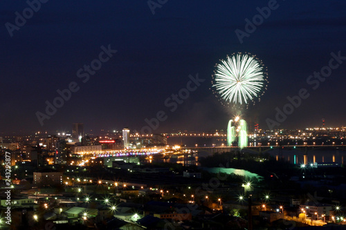 fireworks over the night city - 243295877