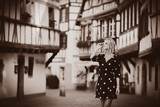 Young style girl in black dress walking down the street in Strasbourg, France, Autumn season time - 243298462