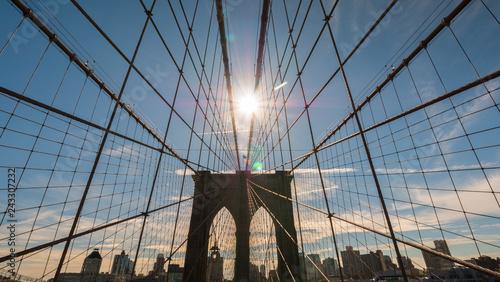 obraz PCV The sun shines over the Brooklyn Bridge in New York