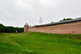 The wall of the ancient fortress in the city of great Novgorod. Novgorod Kremlin. Summer cloudy day. - 243312881