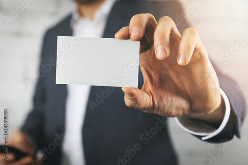 Poster businessman hand showing blank white business card closeup
