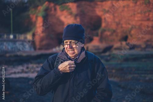 Foto Murales Senior man on the beach in winter