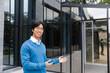 Confident smiling asian businessman