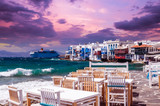 Little Venice, Mykonos island, Greece. Colorful buildings and balconies near the sea and a large white cruise ship. - 243330457