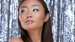 pretty asian young model with party makeup poses to a camera