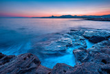 Beautiful mysterious marine landscape at sunset. Volcanic reef and ocean - 243334090