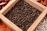 Black peppercorns in box - 243337881