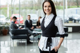 Face of beautiful woman on the background of business people. - 243342648