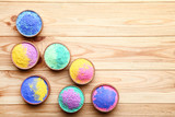Colorful holi powder in bowls on brown wooden table - 243344643