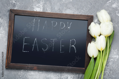 Leinwandbild Motiv Inscription Happy Easter on wooden frame with white tulips