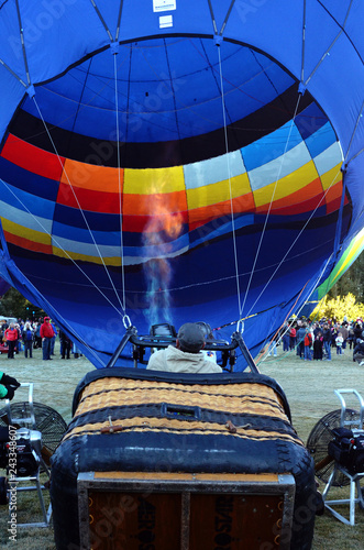 Fill hot air balloon with fire, close up basket view.