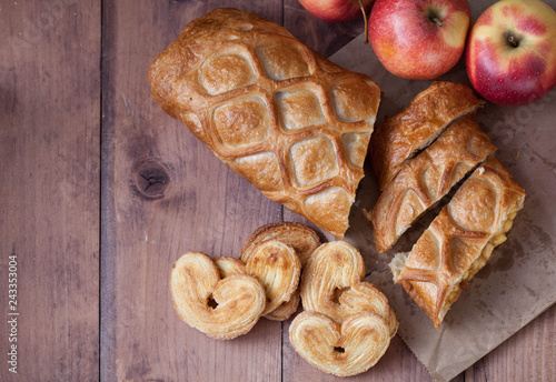 cake with Apple filling and pastry in the shape of a heart with red apples on wooden table