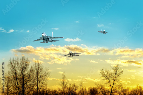 obraz PCV Fighter aircrafts taking off in the sky at sunset.