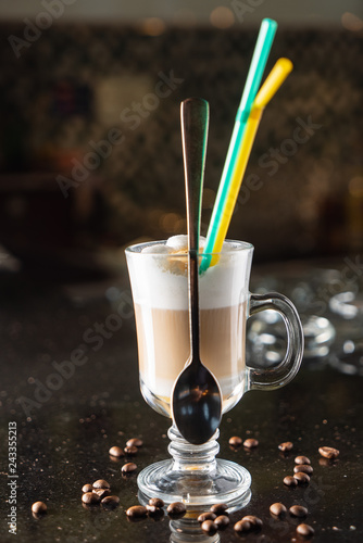 Pumpkin spiced latte or coffee in a glass. Autumn or winter hot drink
