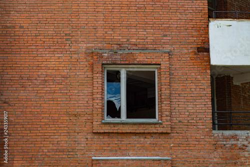 Brick wall with window - 243359017