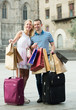 Quadro Smiling couple looking satisfied after shopping