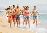 People running at beach - 243362295