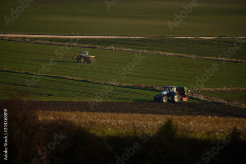 tractors sowing and working fields in the province of alava (the Basque country)