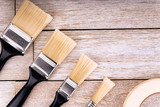 Set of painter tools on a white wooden plank, directly above. Copy space for your text. - 243378276
