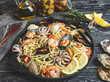 Cooked pasta with clams, shrimps, baby octopus, mussels tomato on a frying pan , spaghetti - 243381647