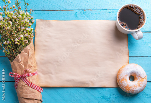 Foto Murales Blank vintage paper with flowers and breakfast on a blue table