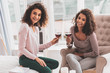 Pretty girls drinking wine celebrating friendship anniversary