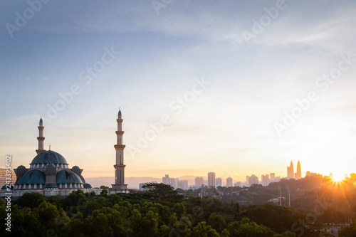 Federal Mosque view during the sunrise with Kuala Lumpur Cityscape