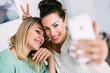 Quadro Two beauty woman taking selfie