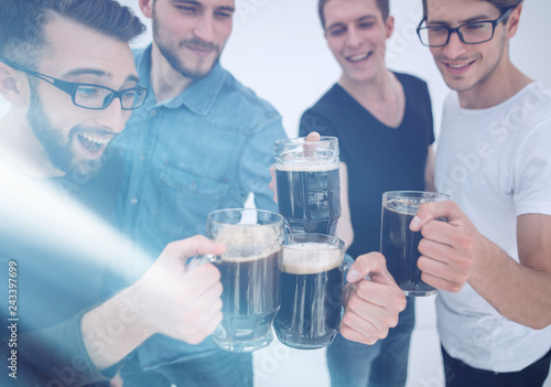 Funny young people with a beer mug full of beer