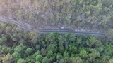 A mountain road hugging valley cliffs deep in the bushland.  Constructed from local sandstone valley walls by hand using pick and shovel. - 243418077