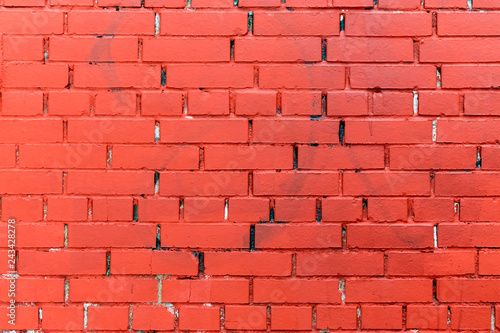 the brick wall is painted in red color - 243428278