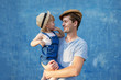 Father and doughter hugging on a blue background. - 243433417