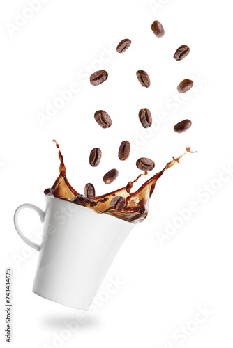 Leinwandbild Motiv Coffee grains flying into cup of espresso with splash