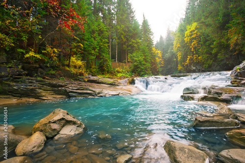 Waterfall on mountain river in the forest
