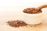 Close up flax seed in wooden spoon , super food with hight of a fiber nutrient and anti inflammatory omega-3 fatty acids - 243438060