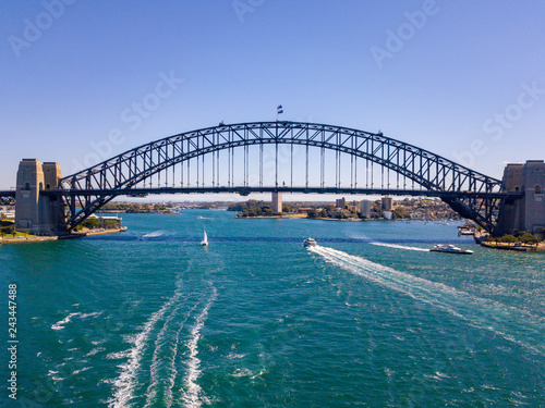 Foto Murales Aerial view on Harbour Bridge arch over harbour Sydney Australia near opera house from above during sunny summer day